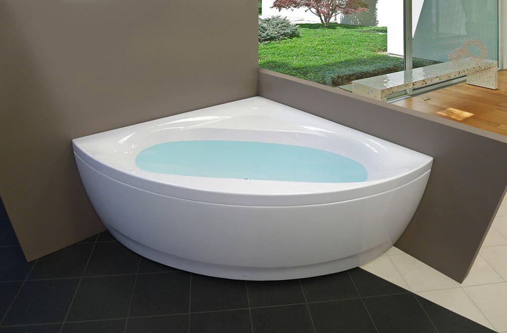 Acrylic Bathtub as the Highlight of Modern Bathroom Interior. Sector form of the bathtub with oval inside shape