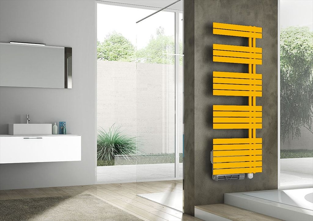 Absolutely amazing modern bathroom design with striking yellow heated towel rail spot