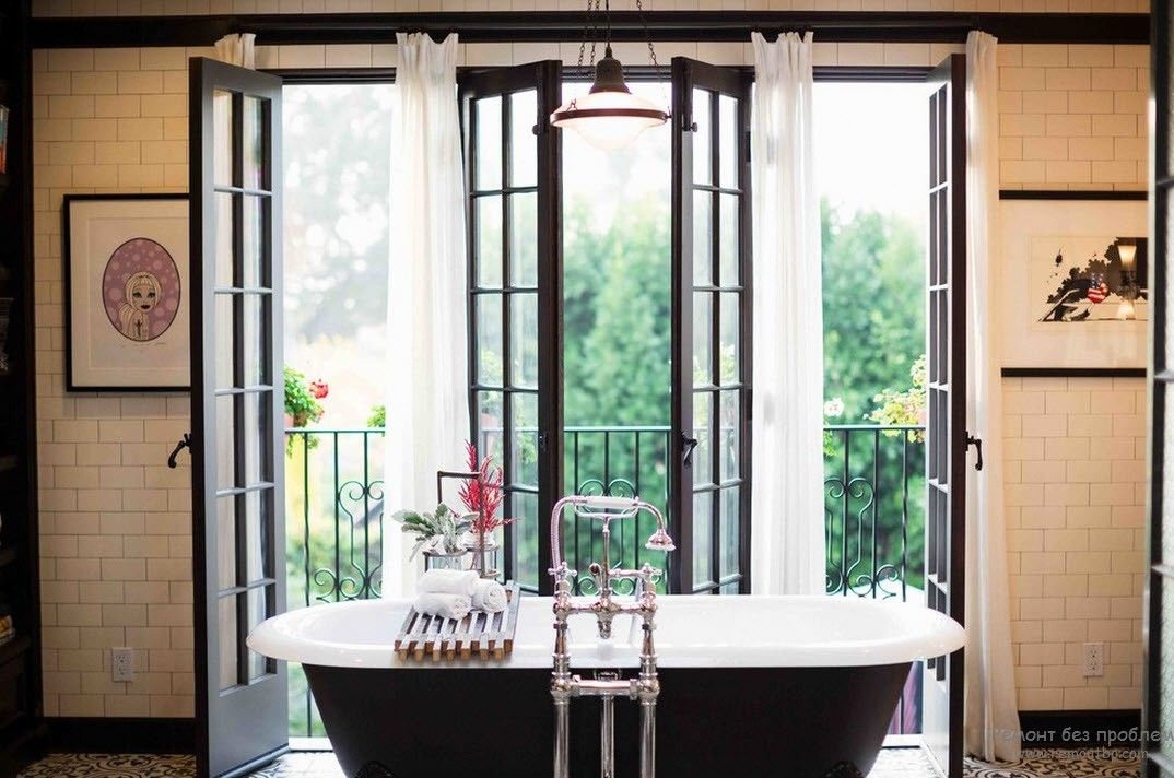 French Interior Design Style Overview. Extravagant bathroom with black painted bathtub and panoramic windows