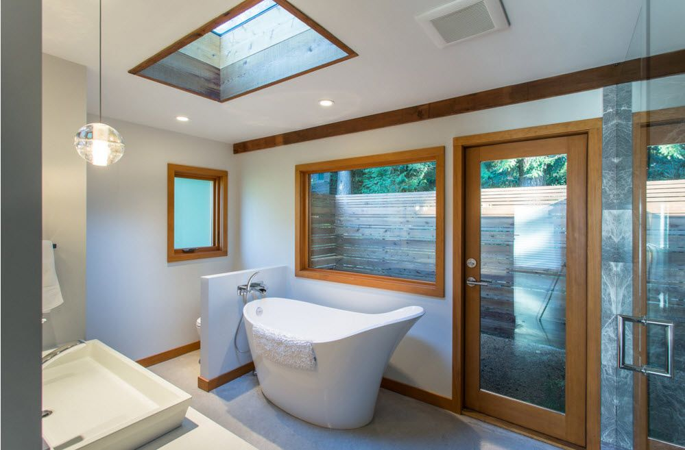 Skylight and two other windows in wooden frames for modern designed bathroom