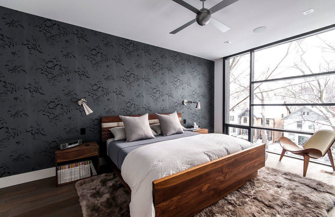 140 Square Feet Bedroom Interior Decoration: Examples for every Budget. Dark accent wall at the headboard and light ceiling, panoramic window and wooden sided bed