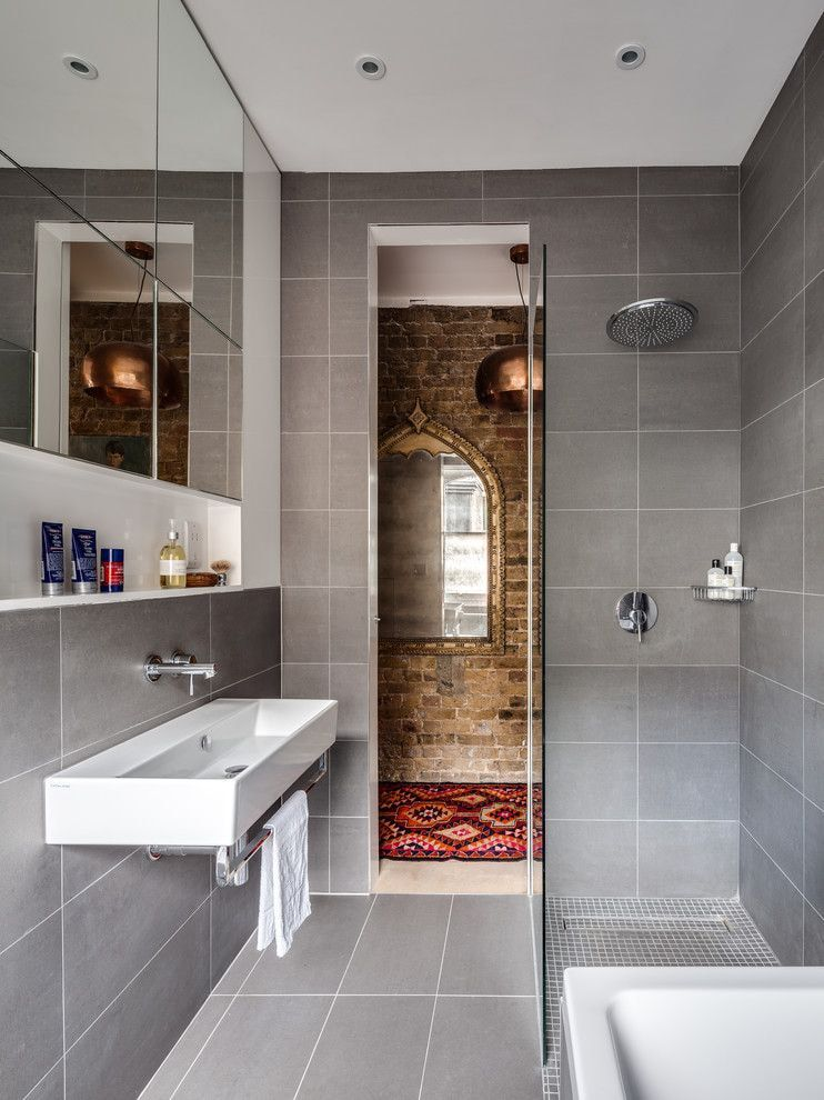 Gray tile and linear strokes for design of the bathroom