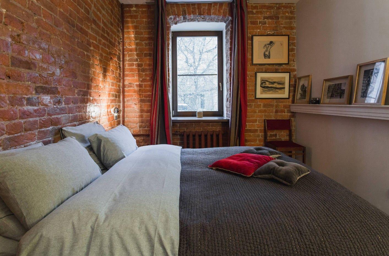 Nice genuine brickwork wall decoration of the bedroom