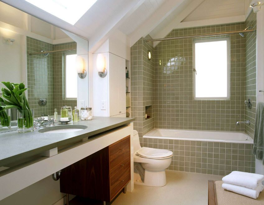 Shallow pale green tiles in the casual styled bathroom