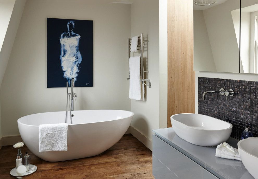 Stone bathtub in the modern bathroom with laminated floor