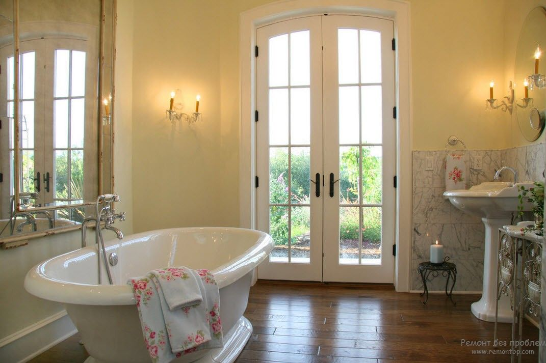 French Interior Design Style Overview. White interior design and a terrace right at the bathroom