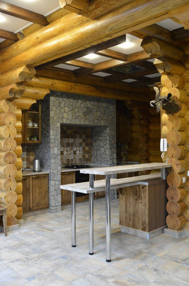 House of wooden frame with small cooking zone extended with bar counter