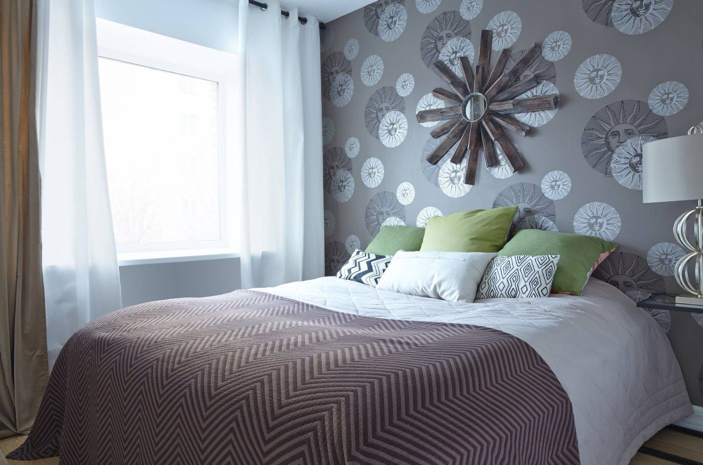 Nice decoration fo the small bedroom with pattern of the wallpaper and installation at the headboard