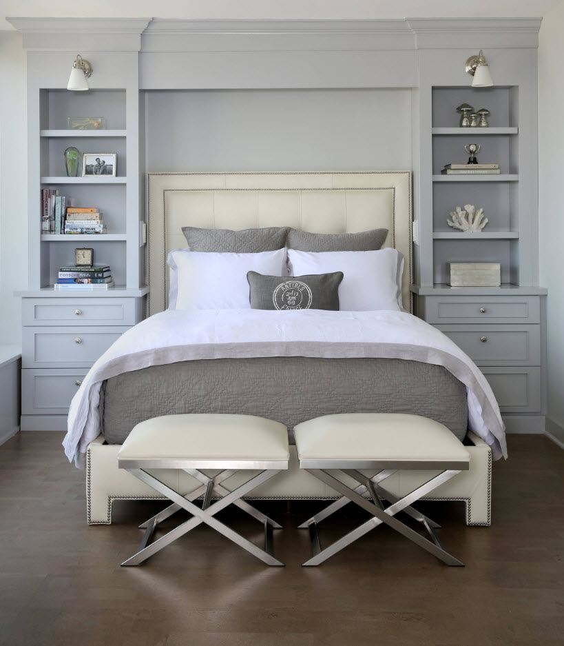 Contemporary designed bedroom with gray walls and storage at the bedside