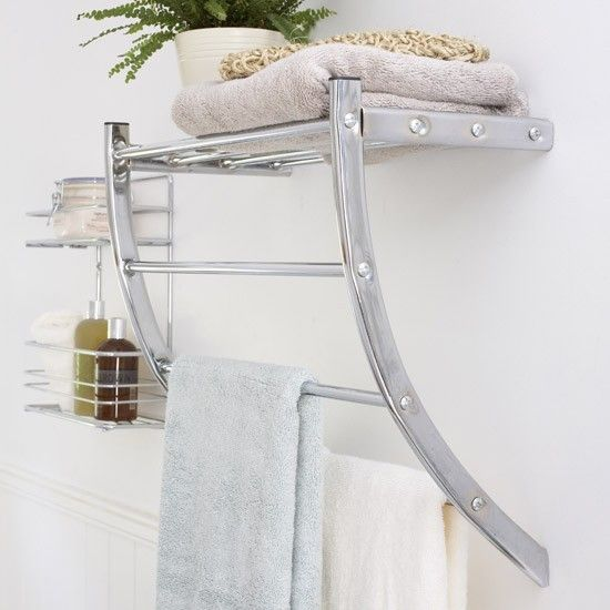Heated Towel Rail in Bathroom Interior as Practical and Decorative Item. Cute steel gloss in the bathroom