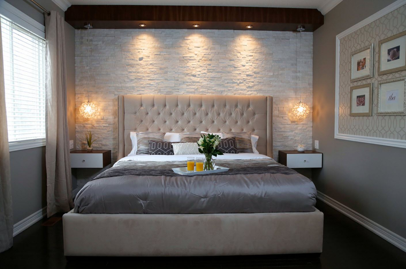 140 Square Feet Bedroom Interior Decoration: Examples for every Budget. Gray toned atmosphere of the modern bedroom with quilted headboard and textured wall behind it