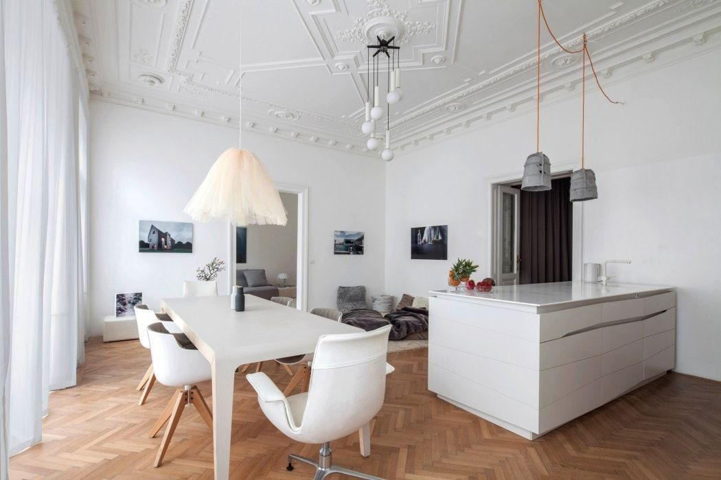 Casual interior in white with natural wooden floor and plastic coated furniture