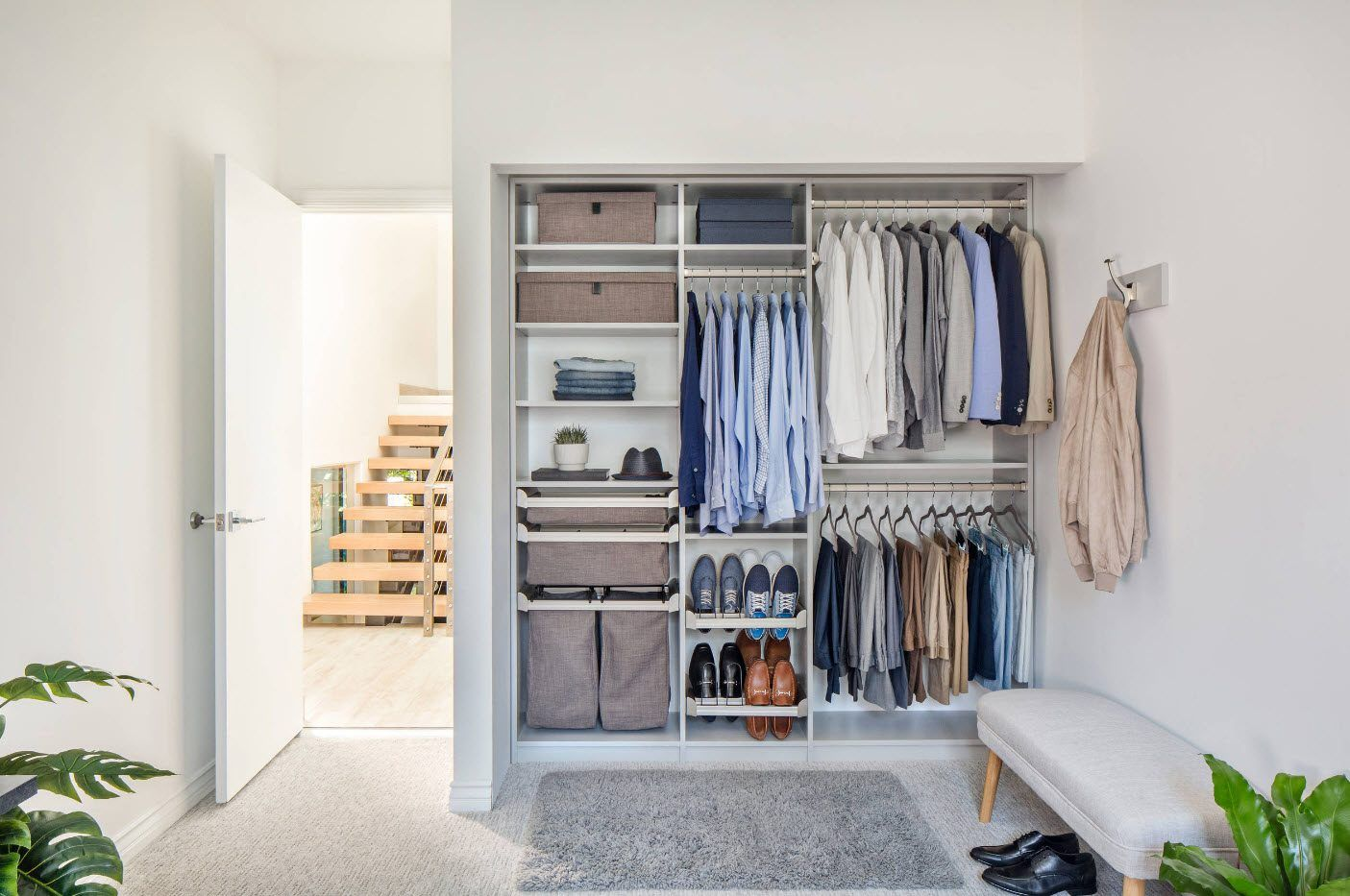 Full-fledged bedroom wardrobe in the modern styled private house