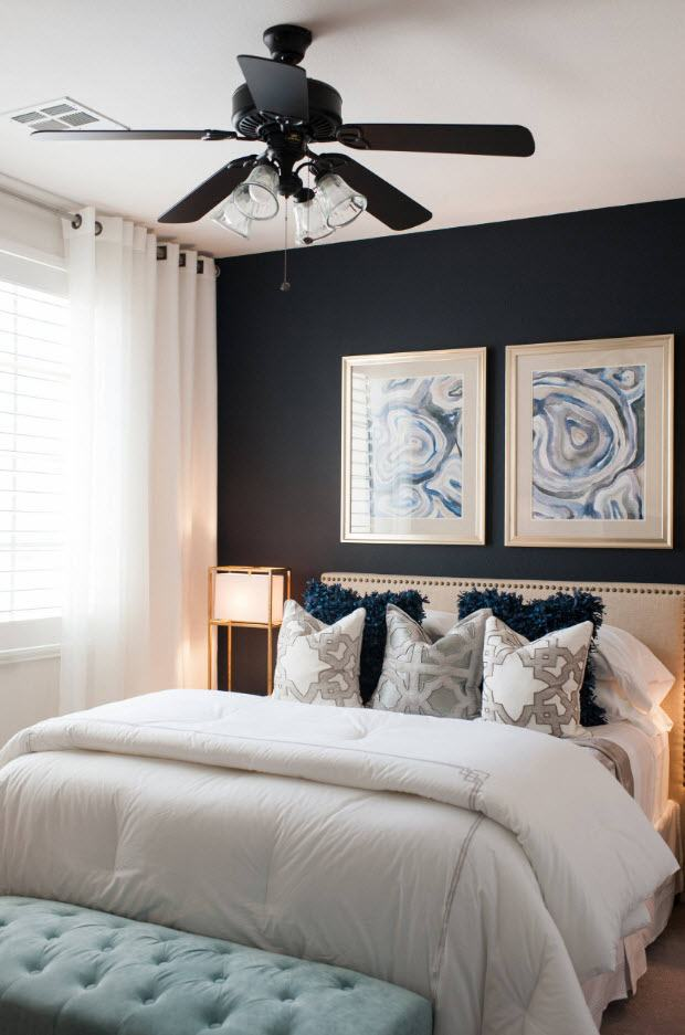 Dark headboard wall and two pictures