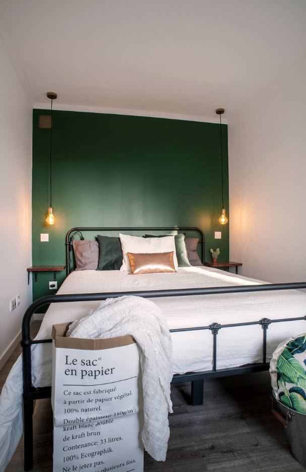 140 Square Feet Bedroom Interior Decoration: Examples for every Budget. Black metal frame and green accent headboard wall