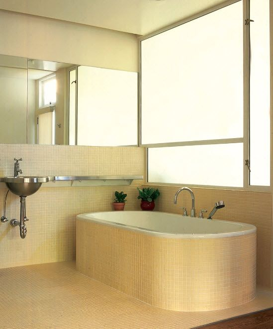 Mix of styles and mosaic trimmed bathtub for small area