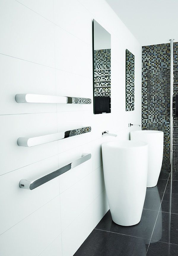 Unusual glossy heated towel rail for ultrmodern and functional bathroom
