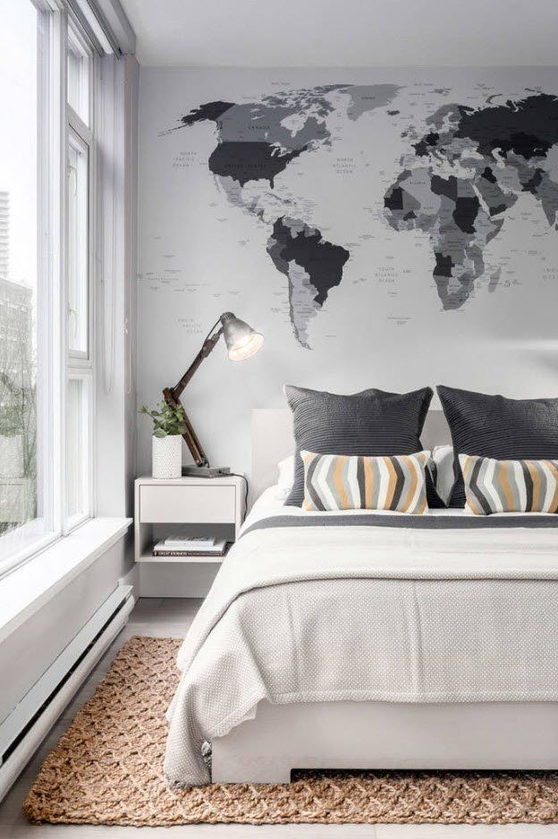 Earth map stylization at the wall of modern designed bedroom