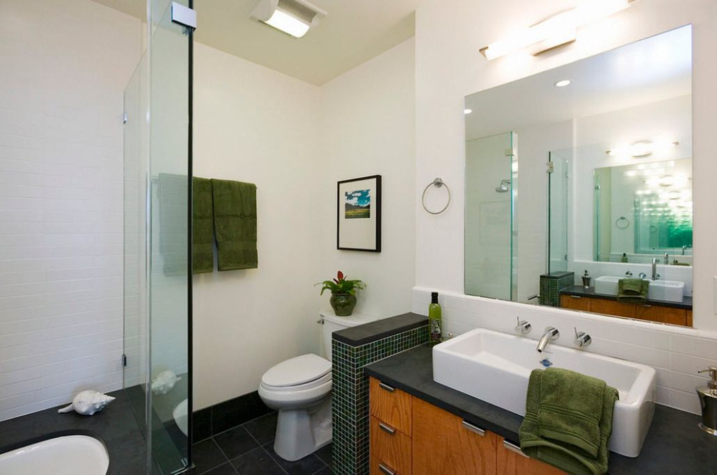 Dark vanity and white walls in the contemporary bathroom interior