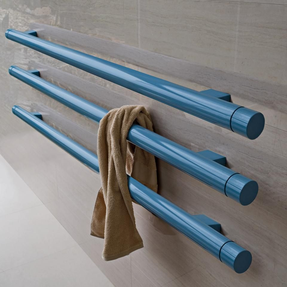 Heated Towel Rail in Bathroom Interior as Practical and Decorative Item. Blue painted pipes in the bathroom