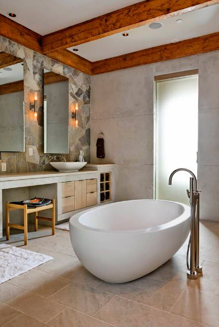 Oval glossy thick bathtub and floor mounted bent tap for modern interior of the bathroom for two
