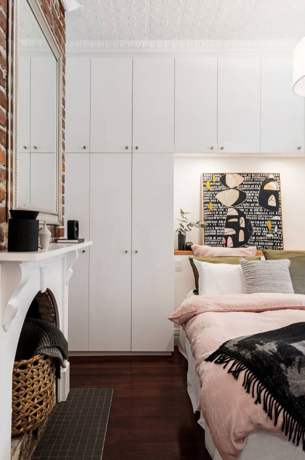White Classic designed bedroom with fireplace and closed storage