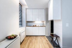 White glossy modern design for small kitchen with laminated floor