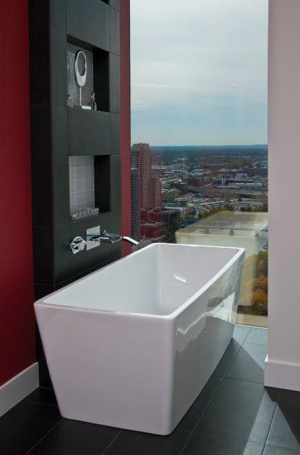 Ultramodern unbeaten bathroom design with unusual white streamline bathtub and narrow panoramic window
