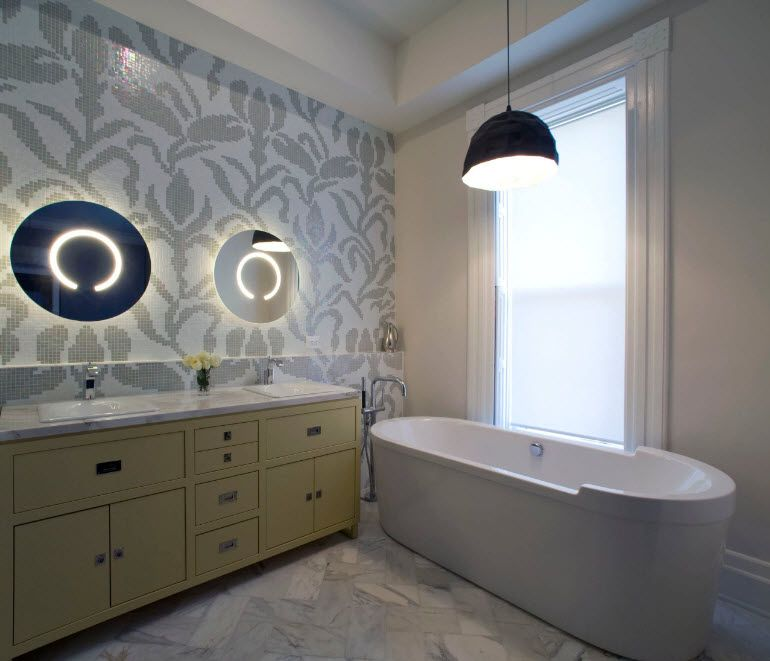 Gorgeous interior decoration in gray with oval bathtub and black lamp over it