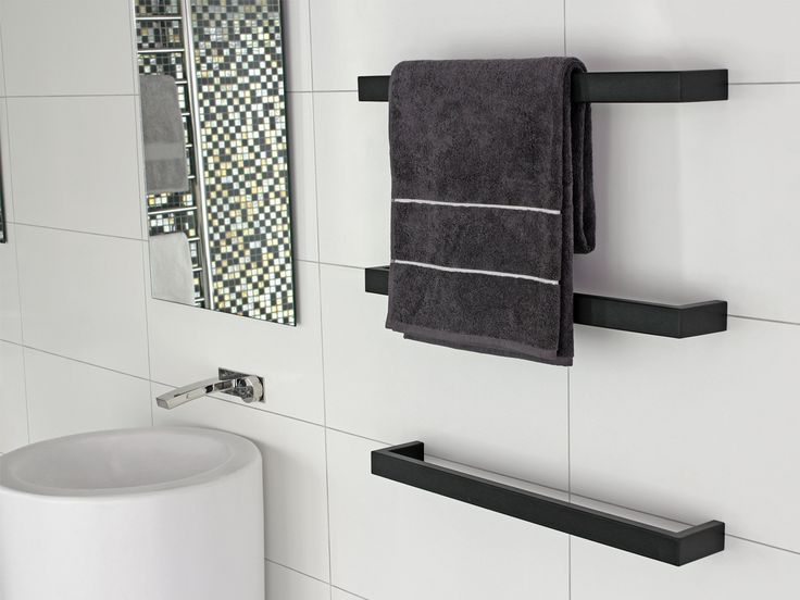 Heated Towel Rail in Bathroom Interior as Practical and Decorative Item. Dark accent in the light space