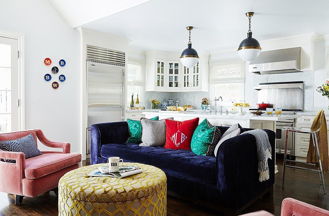 Colorful pillows in the casual interior with round yellow coffee table