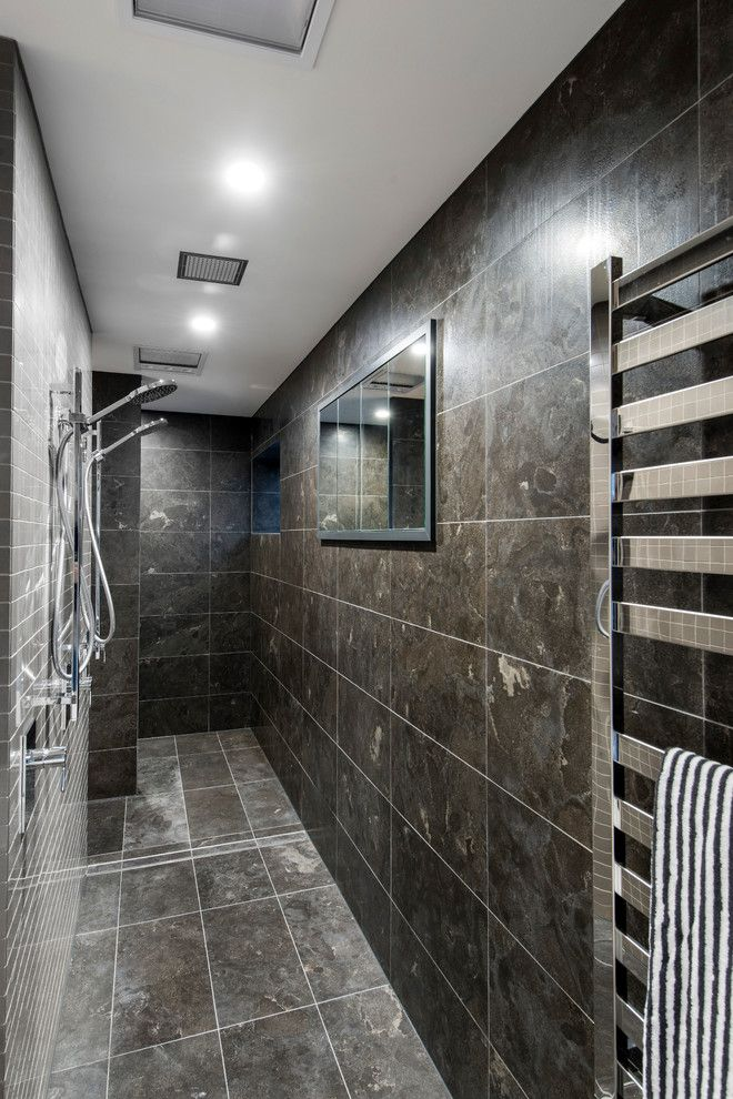 Dark marble imitating tile in the small narrow bathroom
