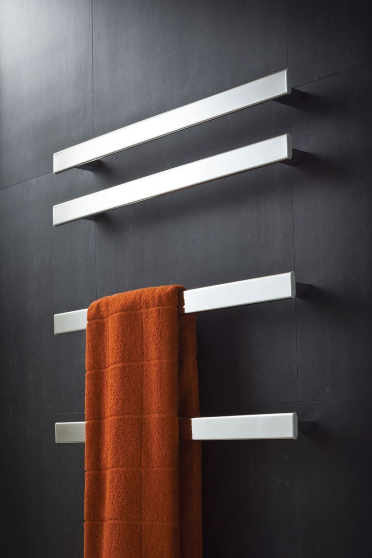 Close-up view of the glossy metal heated towel rail