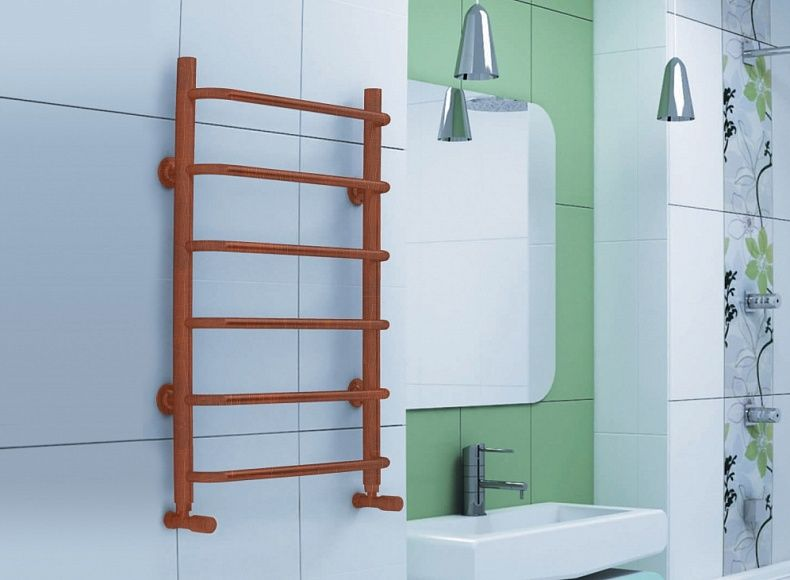 Computer design of the brass heated towel rail in the bathroom interior