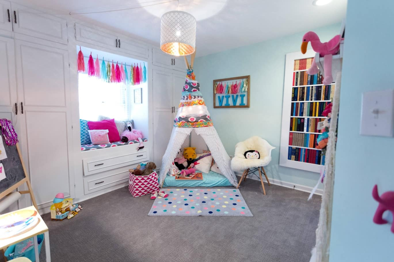 Neat turquoise decoration with storage system and relax place at the window and wigwam for children's room
