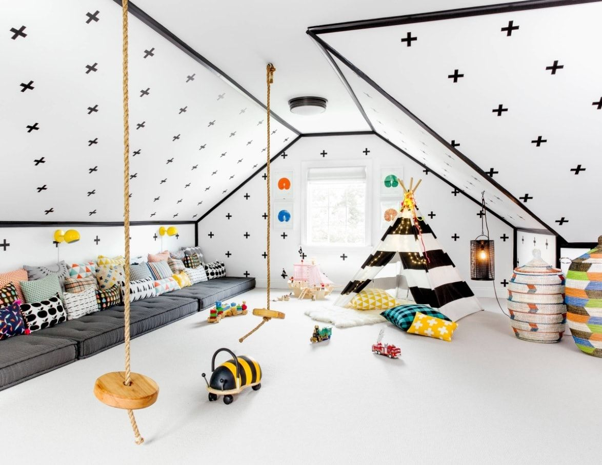 Large light decorated kids' room with darl dots at the walls