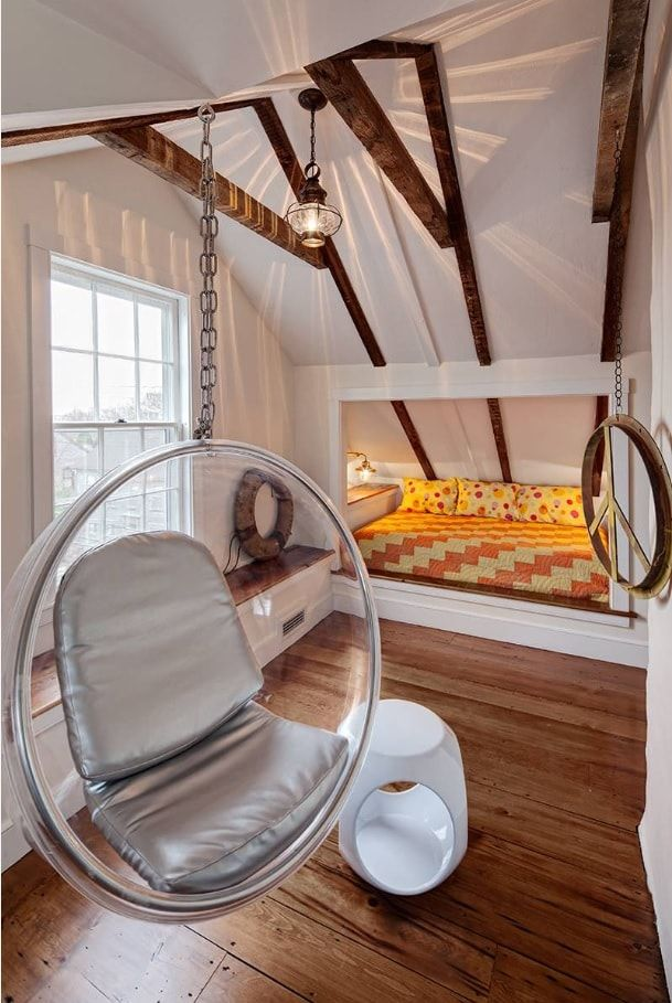 Suspended bubble chair in the guest loft bedroom
