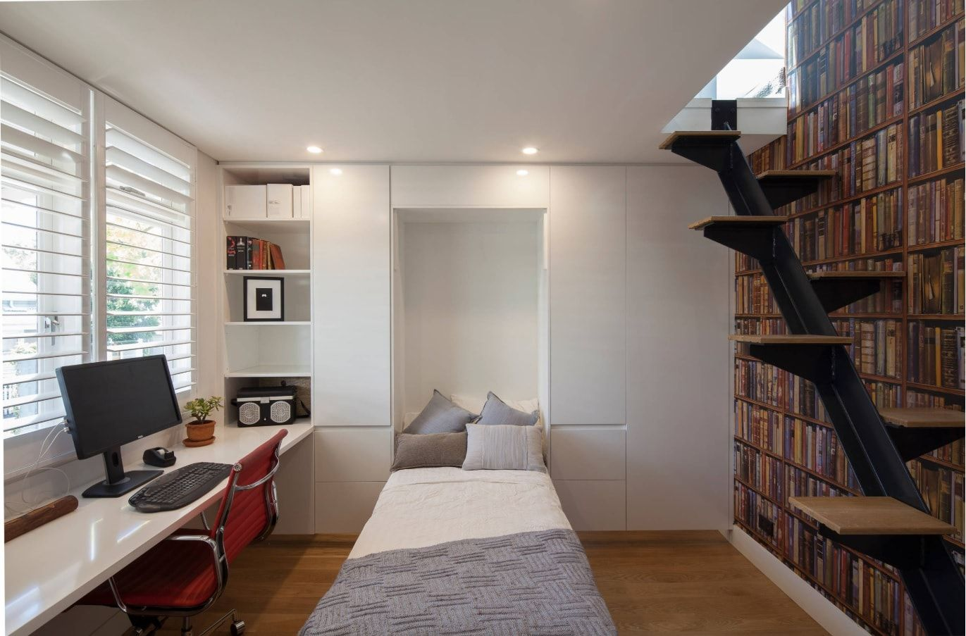 Staircase to the floor above and bedroom with the folding out bed