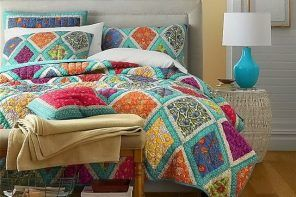 Japanese Patchwork: Cozy Oriental Interior Decoration. Colorful pattern on the coverlet and turquoise lamp