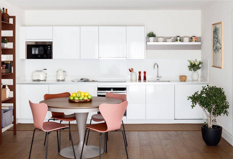 Best Ideas on Tables and Chairs for Small Kitchen. Neat dining zone with pink chairs in the large modern designed kitchen in white