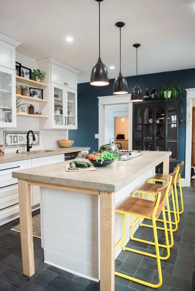 120 Square Feet Kitchen Interior Design Ideas with Photos. Colorful mid-century design with yellow framed chairs