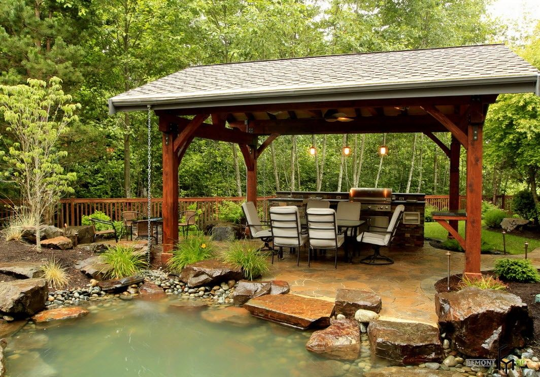 Backyard and Garden Gazebo: Design, Form, Use and Practical Advice. Eastern styled large gazebo in the forest-side backyard
