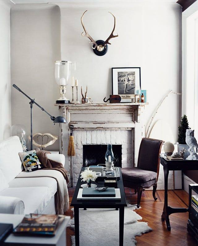 Vintage designed room with gray stucco trimmed fireplace