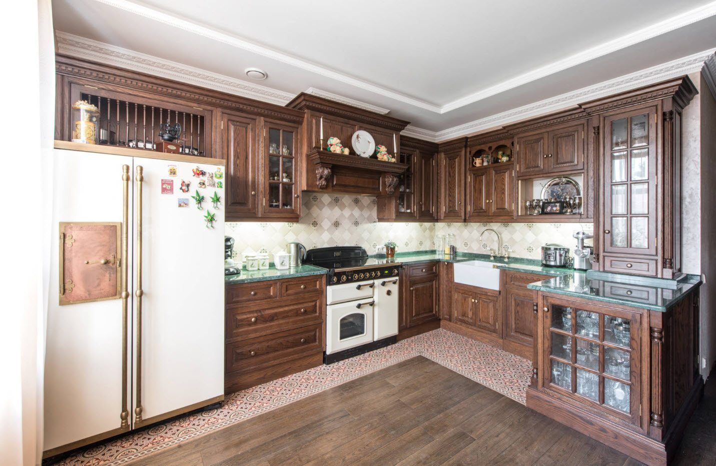 Dark wooden kitchen furniture with white facades of the appliances