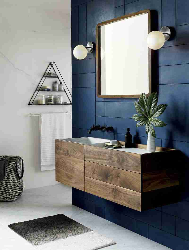 Bathroom Shelves: Fashionable Trends of Practical Interior Decoration. Wooden fashionable suspended vanity and blue contrasting wall
