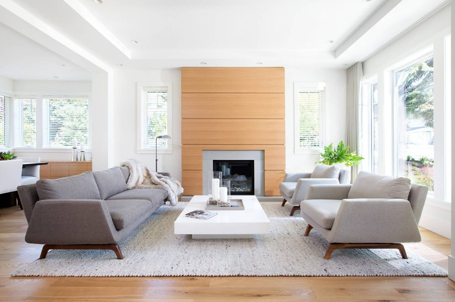 Wooden trimming of the accent wall in ultramodern living room