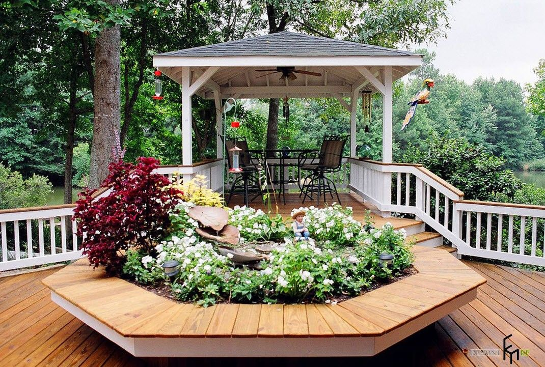 Light wooden constructed gazebo with fence