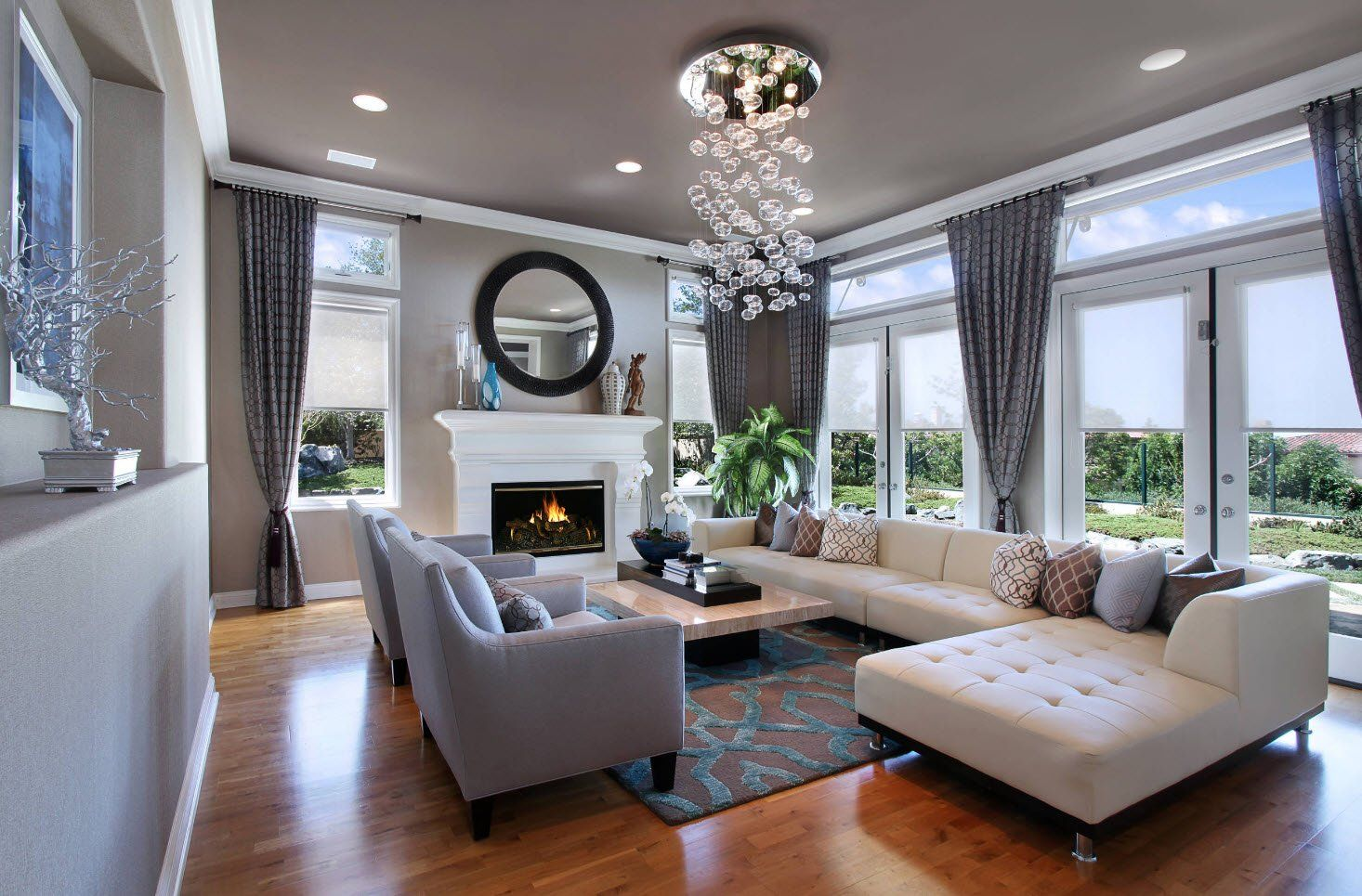 150 Square Feet Living Room Best Arrangement Ideas. Gray designed room with crystal chandelier