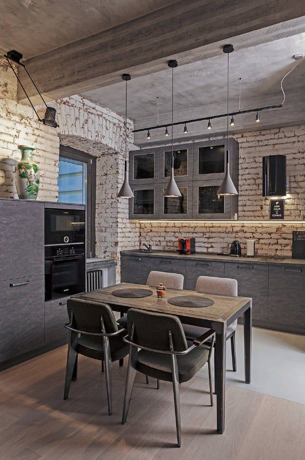 Industrial interior with whitewashed brickwork and gray furniture