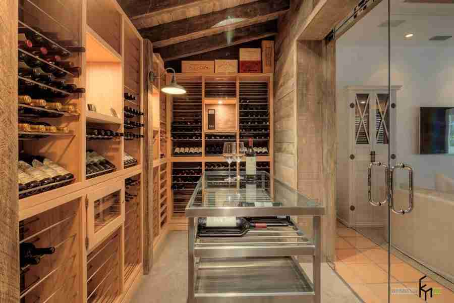 Unusual design for a large house with a glass table in the wine cellar